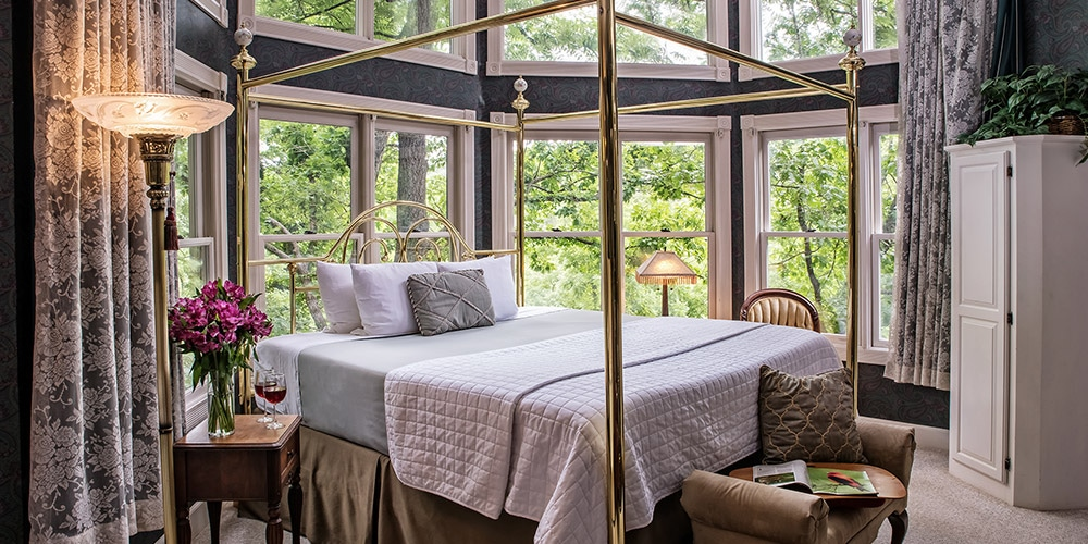 Luxurious Guest Rooms at romantic getaway packages await at our Eureka Springs Bed and Breakfast